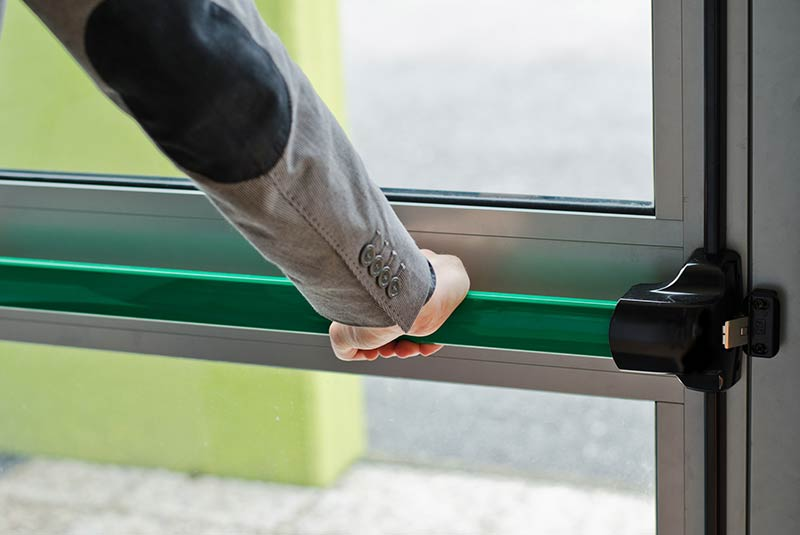 Person opening a security door