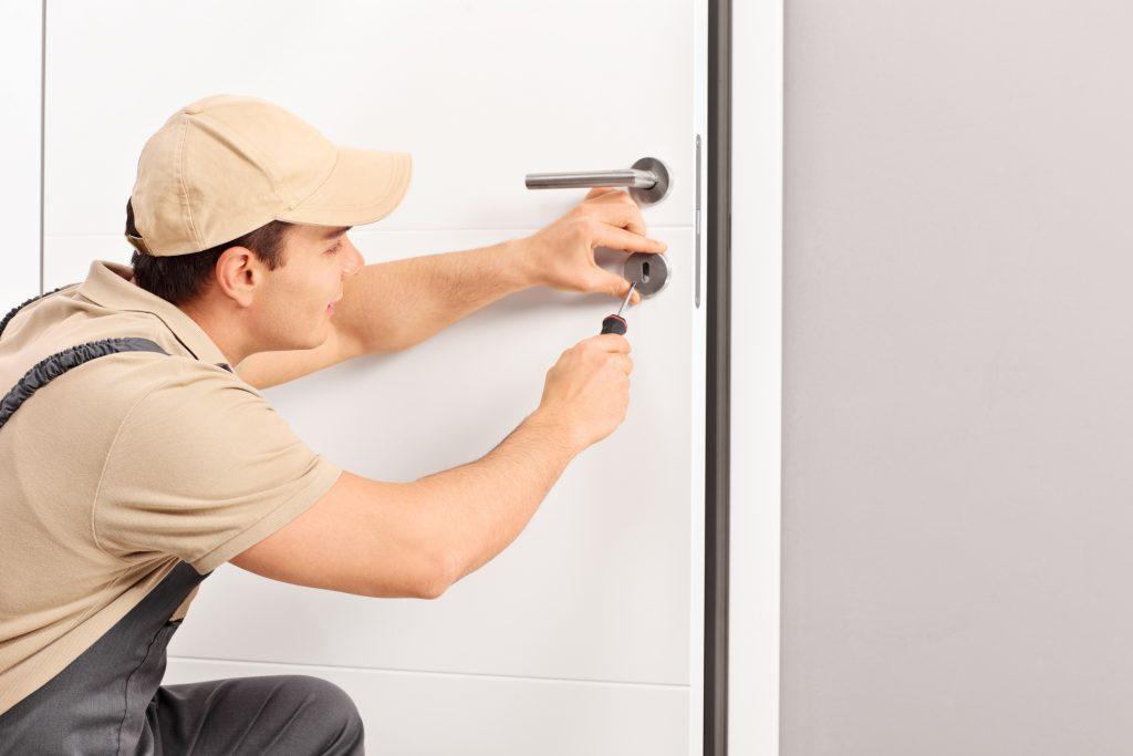 Worker Installing Door Lock